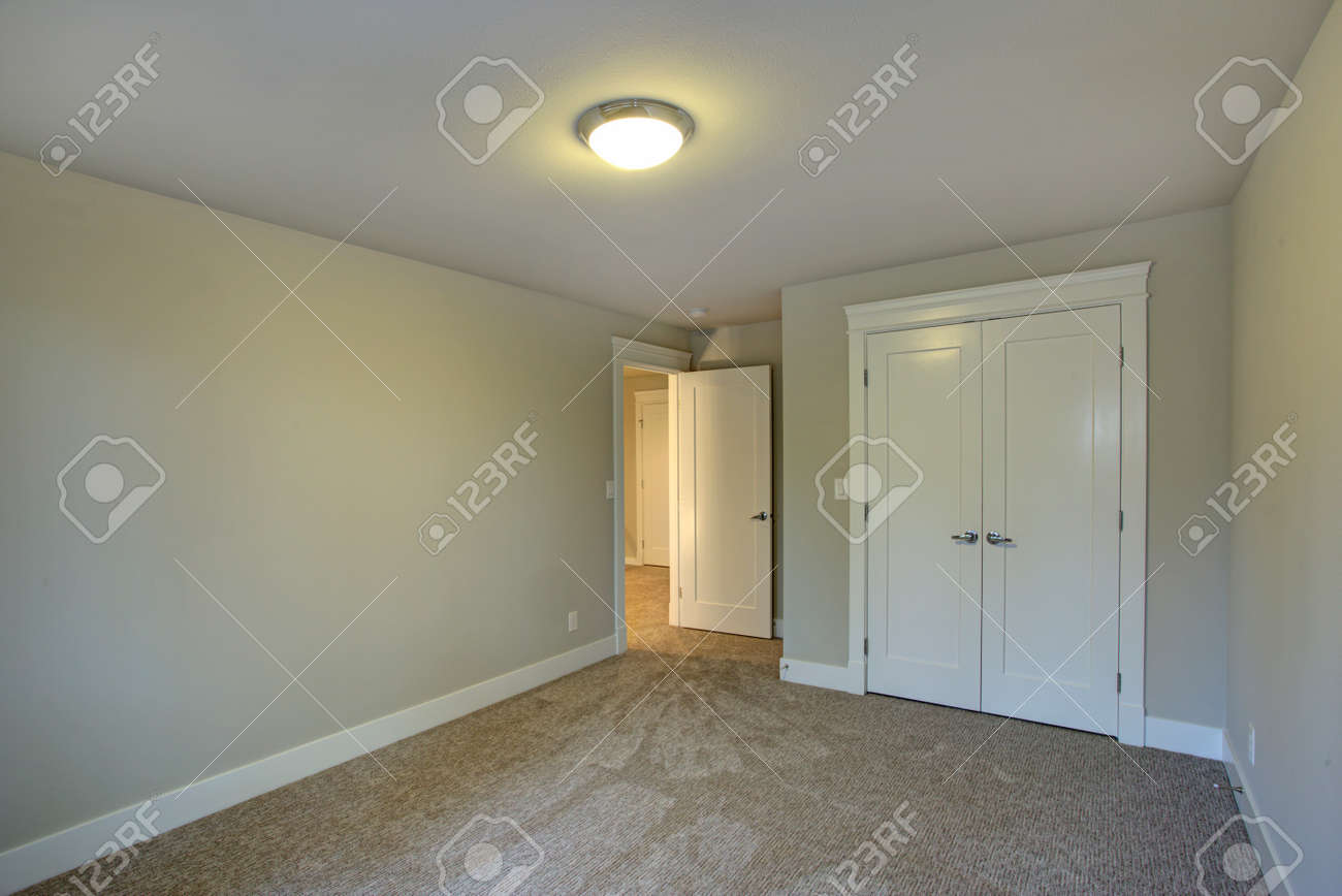 new construction home interior features empty room with pale stock
