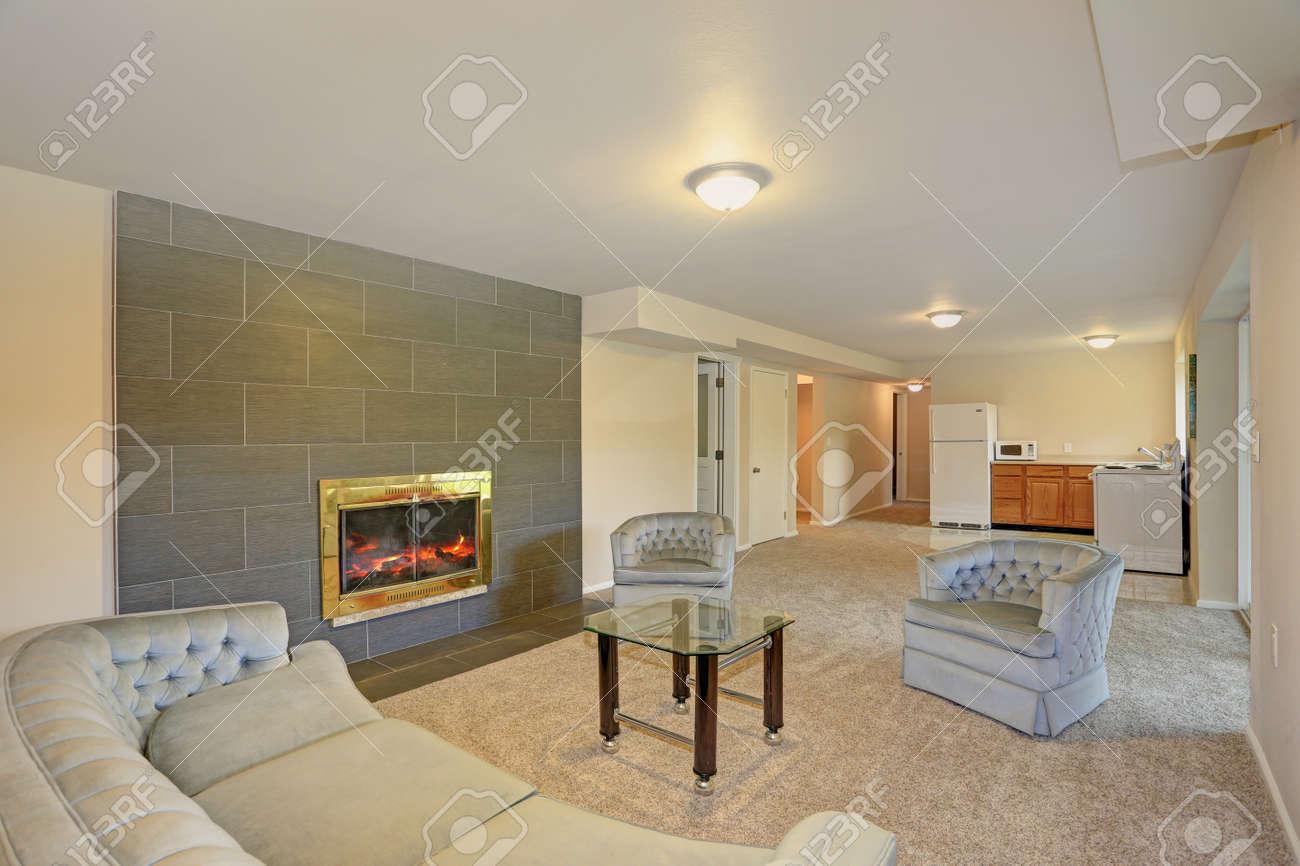 Minimalist Living Room Design With Light Gray Tufted Sofa Facing