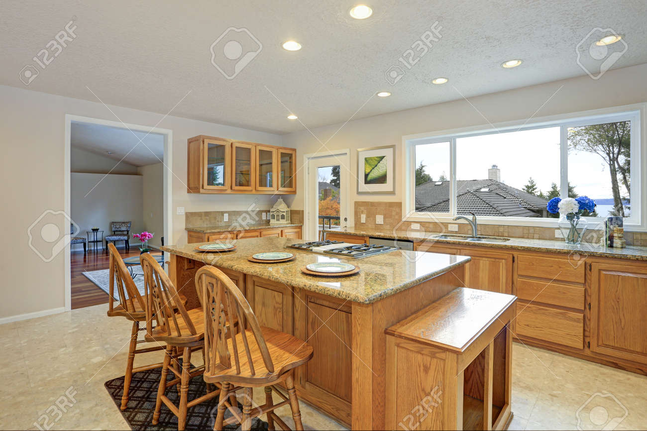 Remodeled Natural Light Kitchen With Wooden Kitchen Cabinets Stock Photo Picture And Royalty Free Image Image 90857369