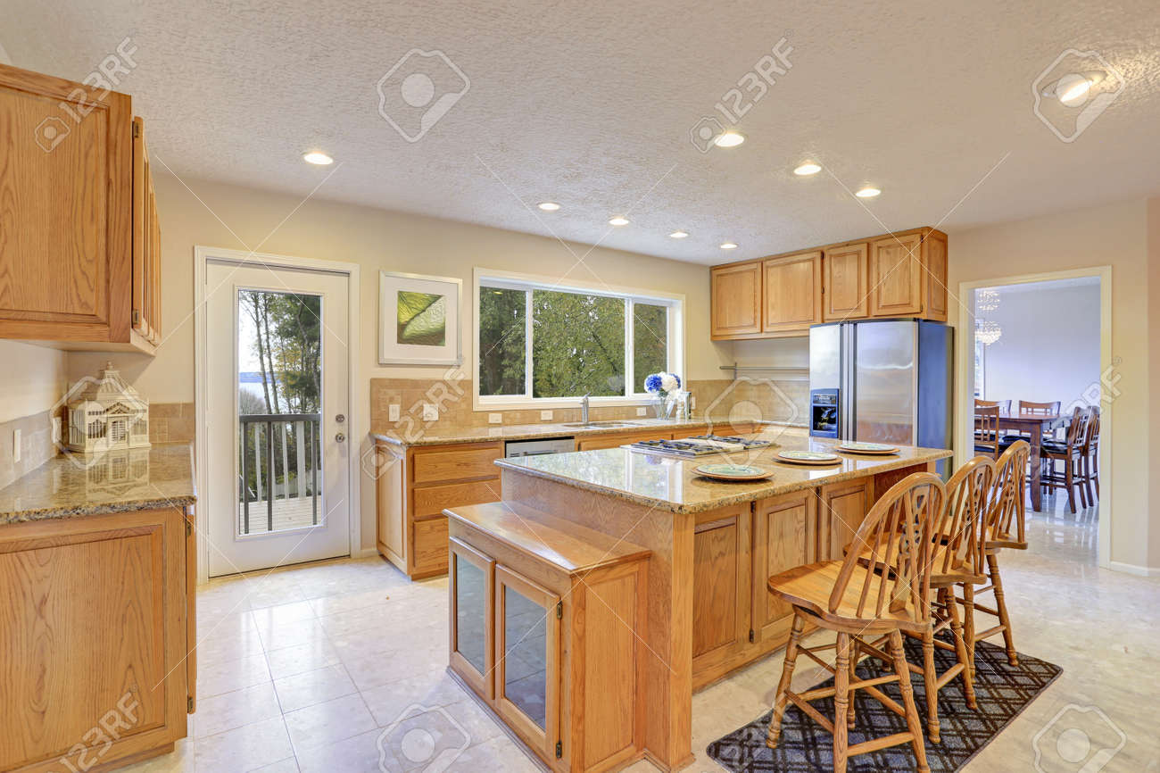 Remodeled Natural Light Kitchen With Wooden Kitchen Cabinets Stock Photo Picture And Royalty Free Image Image 90857371