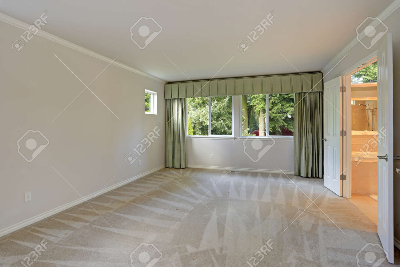 Empty Room Interior With Carpet Floor Grey Walls And Green Curtains Stock Photo Picture And Royalty Free Image Image 90857373