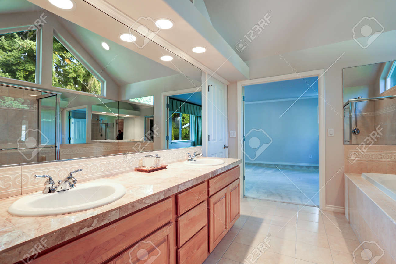 Bright And Airy Master Bathroom Has Marble Countertops With Double ...