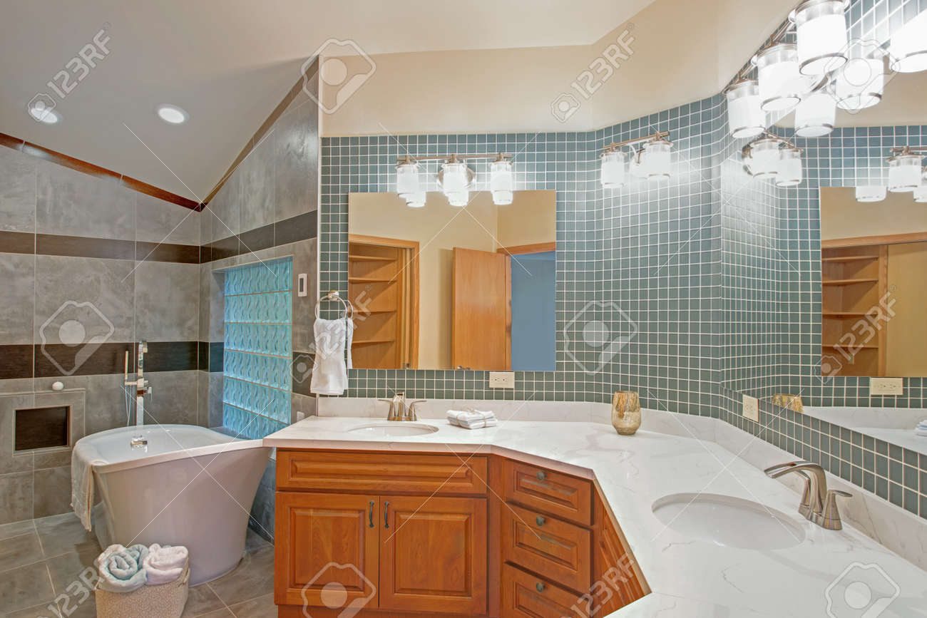 Stunning Bathroom With Light Wood Vanity Paired With Calcutta Stock Photo Picture And Royalty Free Image Image 91175237