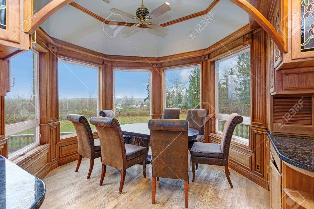 Bay Window Breakfast Nook Features Large Windows Framing An Oval ...