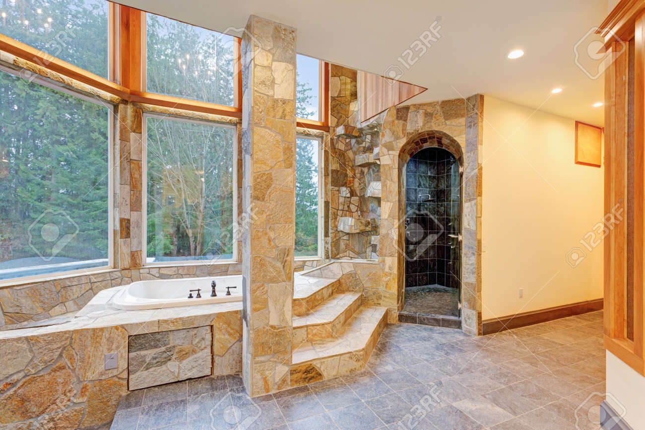 Luxurious Mansion Bathroom Features Drop In Bathtub Paneled In Stock Photo Picture And Royalty Free Image Image 91635164