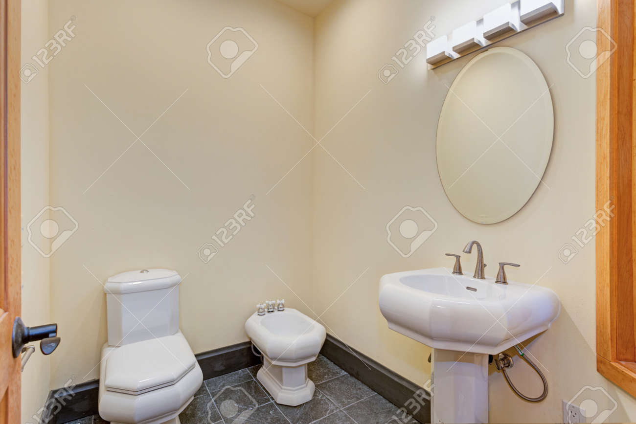 Yellow Powder Room Design Filled With White Appliances: A Pedestal ...