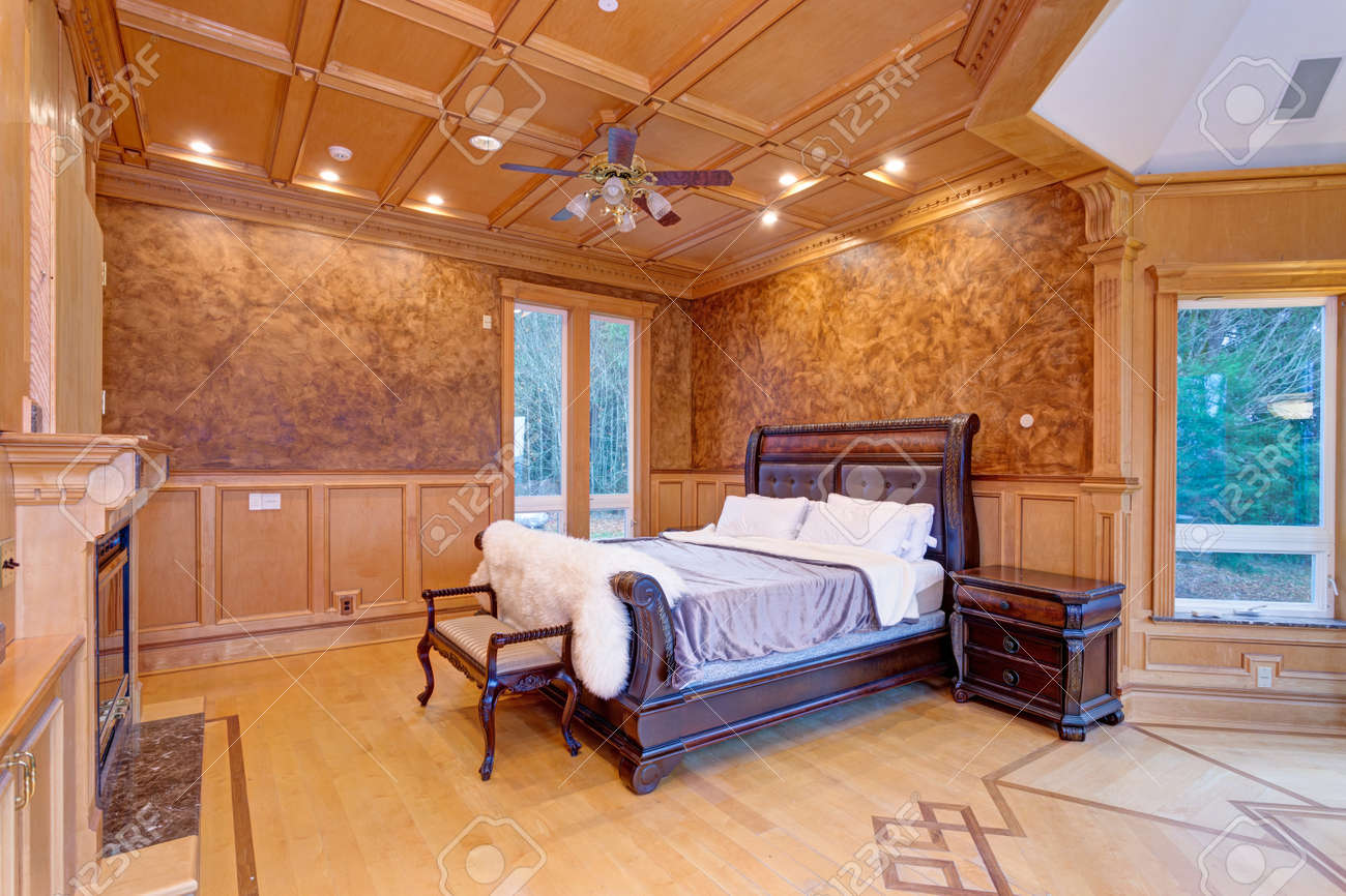 Welcoming Mansion Bedroom Features A Rustic Wood Coffered Ceiling