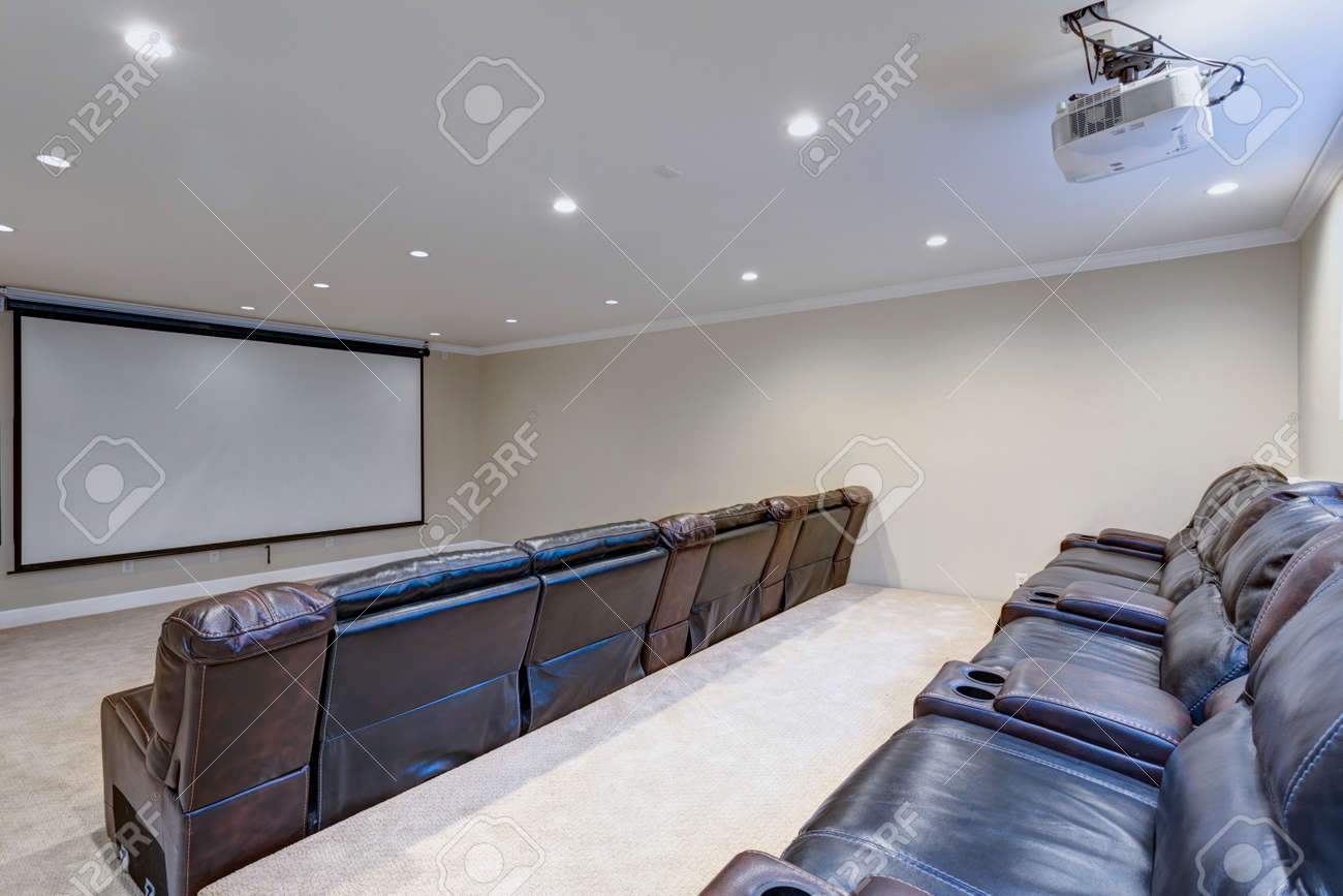 Contemporary Basement Movie Room Features A White Ceiling Accented Stock Photo Picture And Royalty Free Image Image 91634827