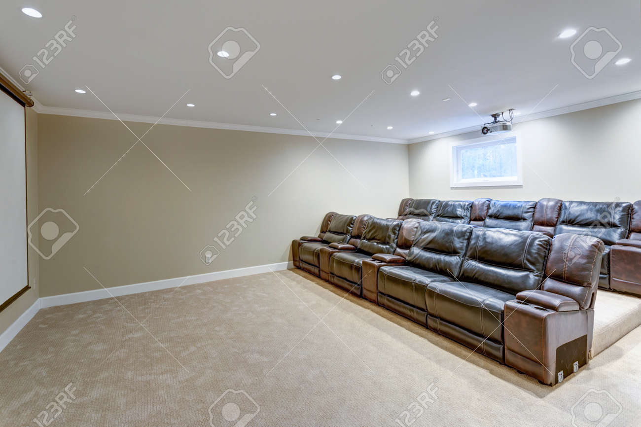 Contemporary Basement Movie Room Features A White Ceiling Accented