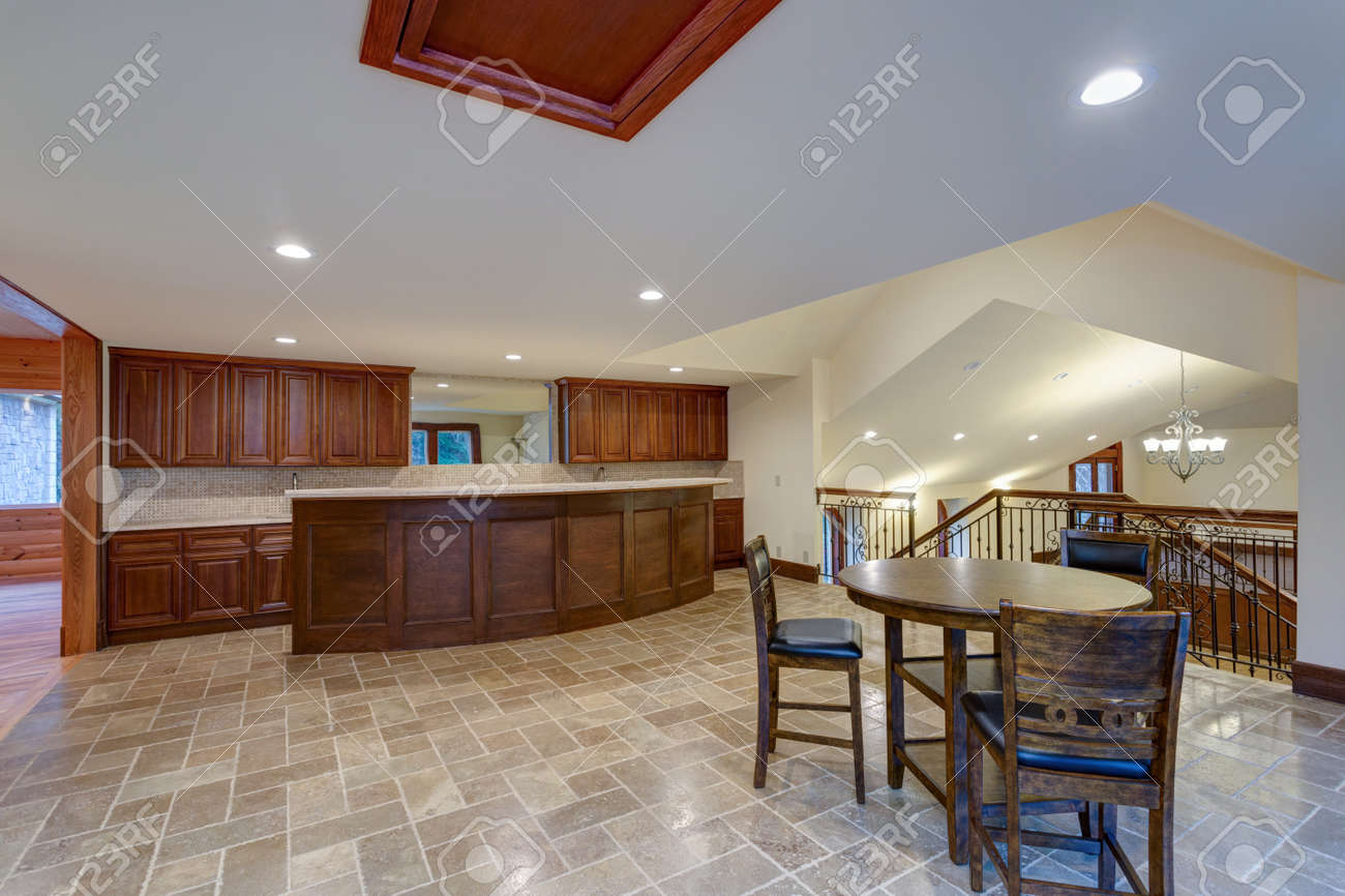 Stock Photo Wedding Venue Interior Features White Kitchen With Breakfast Bar And Nook Atop Grey Tile Floor: Grey White Wedding Venues At Websimilar.org