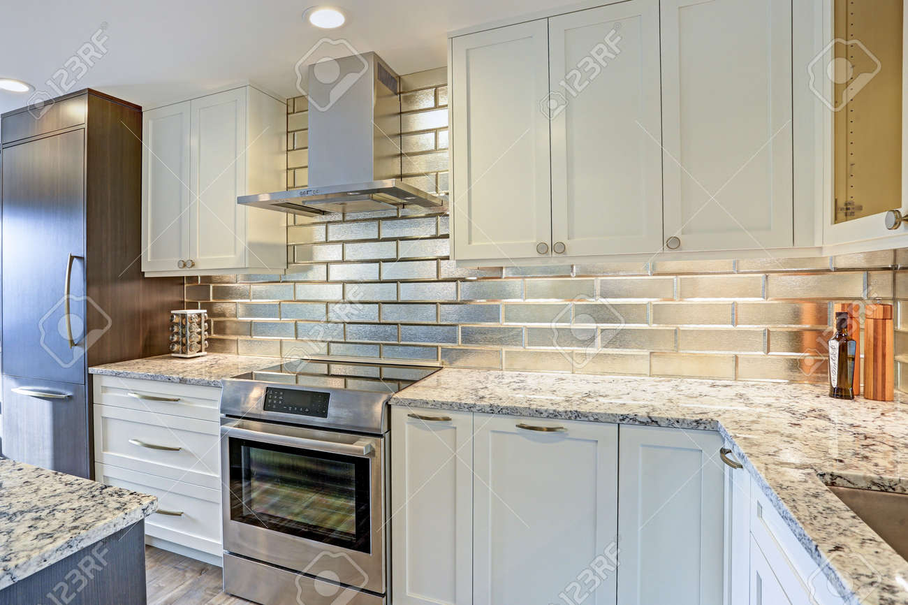 - Modern White Kitchen Design With Silver Backsplash, White Shaker