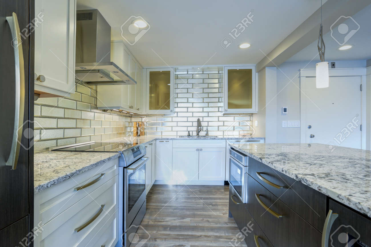 Well Appointed Kitchen Features A Large Kitchen Island Topped Stock Photo Picture And Royalty Free Image Image 93392744