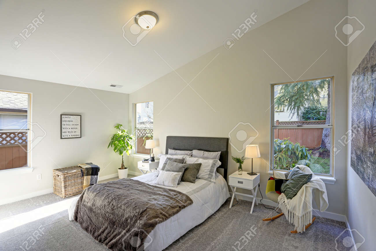 Cozy Bedroom Interior With Vaulted Ceiling A White Bed With