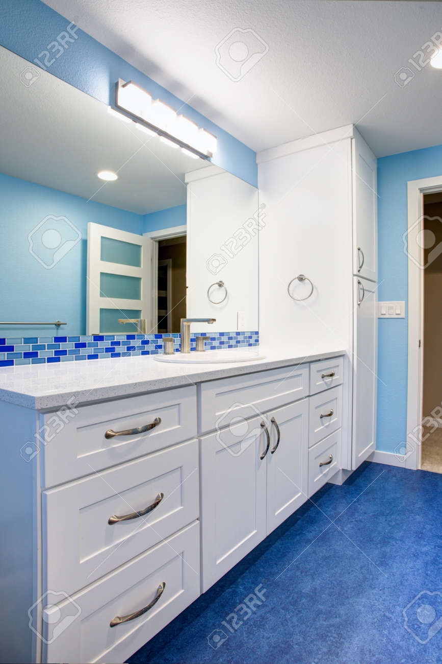 - Gorgeous Bathroom With Blue Walls, Extra-wide Creamy White Single
