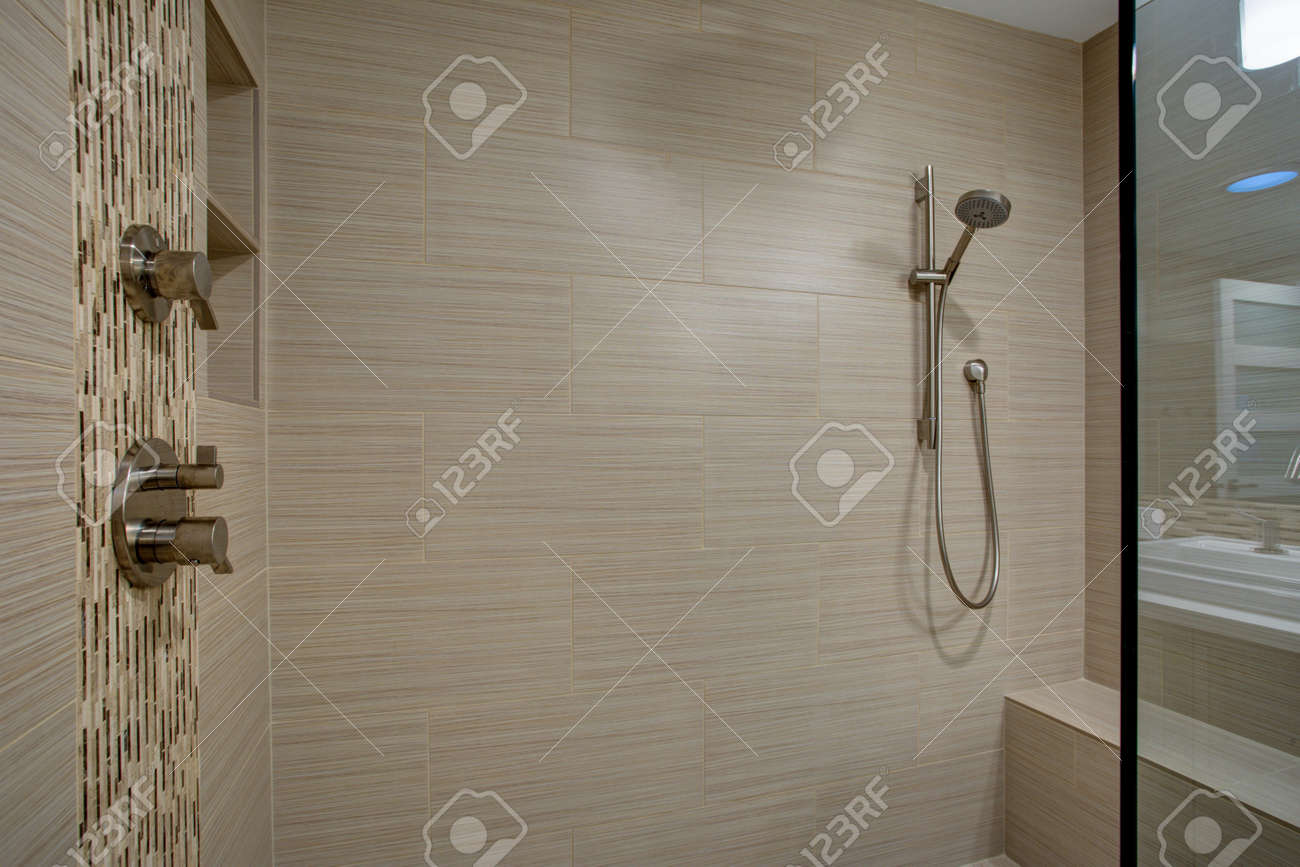 Chic Walk In Shower With Built In Bench And Beige Subway Tiled