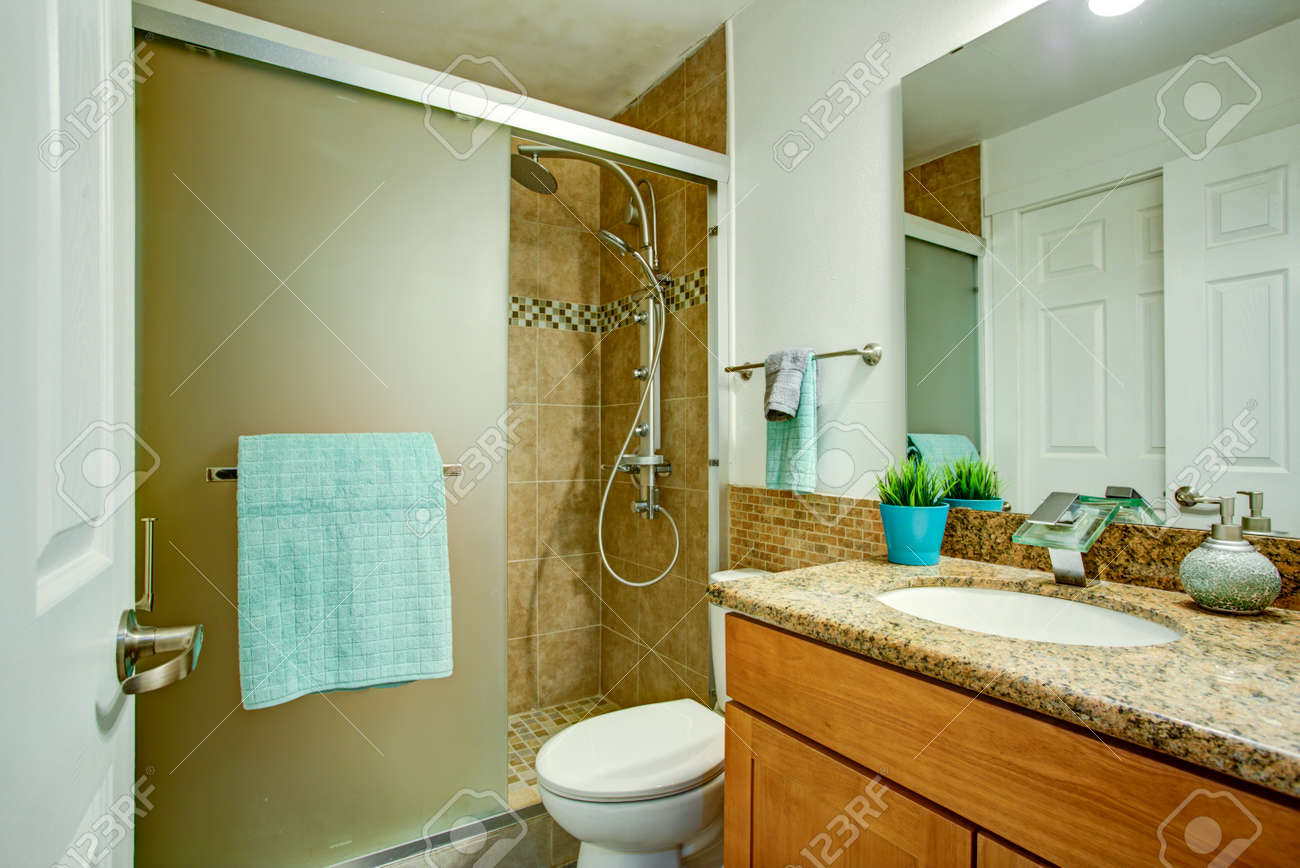 Brown And White Bathroom Design Features Wooden Vanity Cabinet Stock Photo Picture And Royalty Free Image Image 96303302