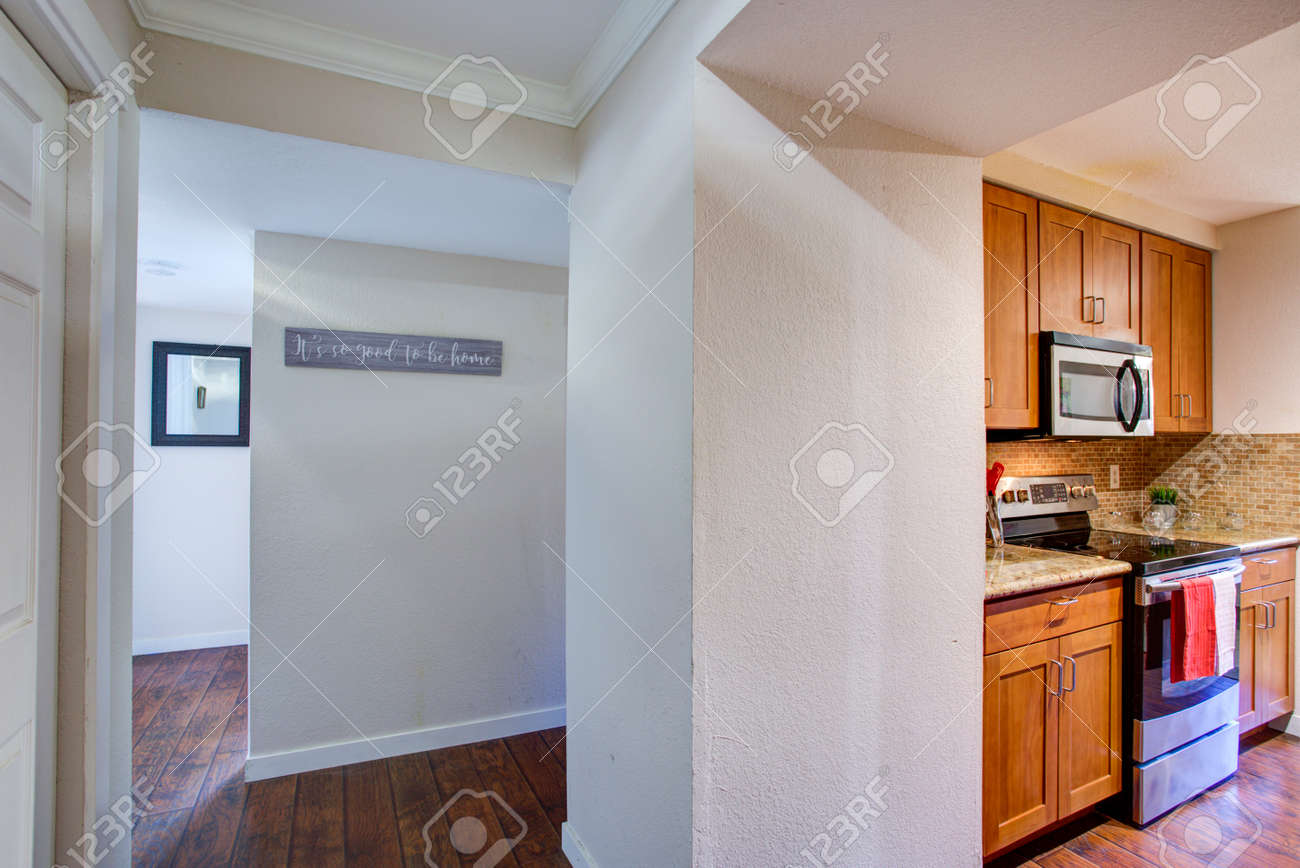 View Of Small Galley Kitchen Design From The White Hallway In
