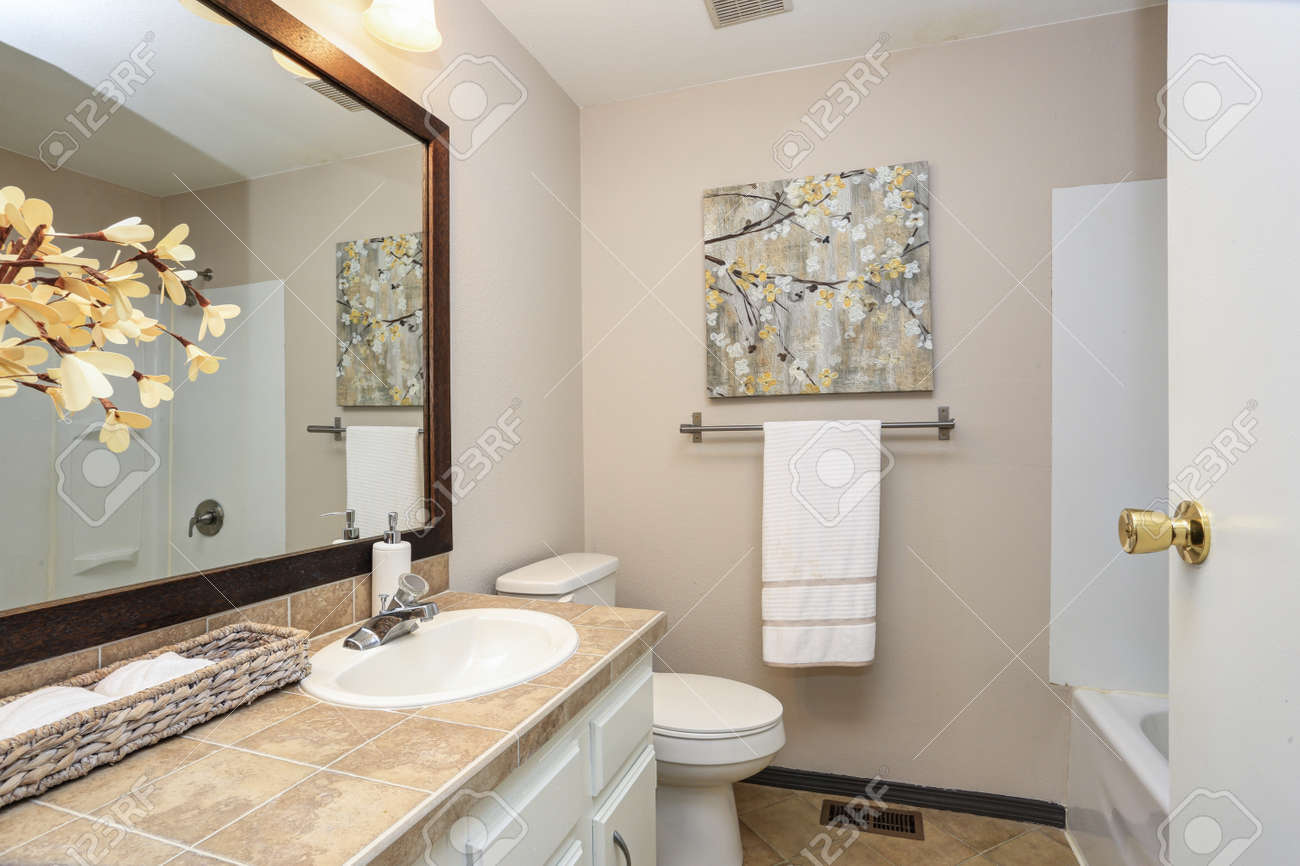 Creamy White Bathroom Boasts A Vanity With Beige Stone Look Tiles - Beige-stone-bathroom-tiles