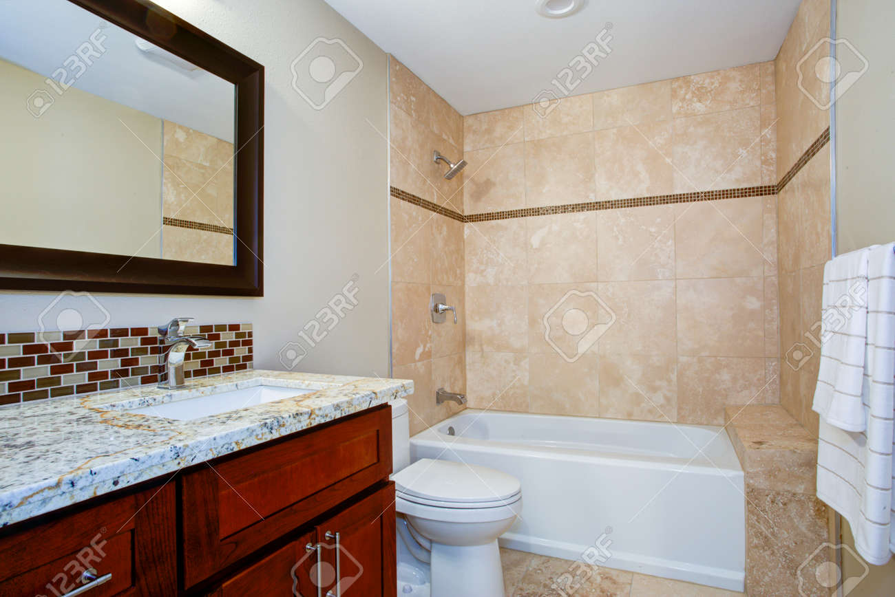 - Elegant Bathroom With A Mahogany Stained Vanity With A Granite