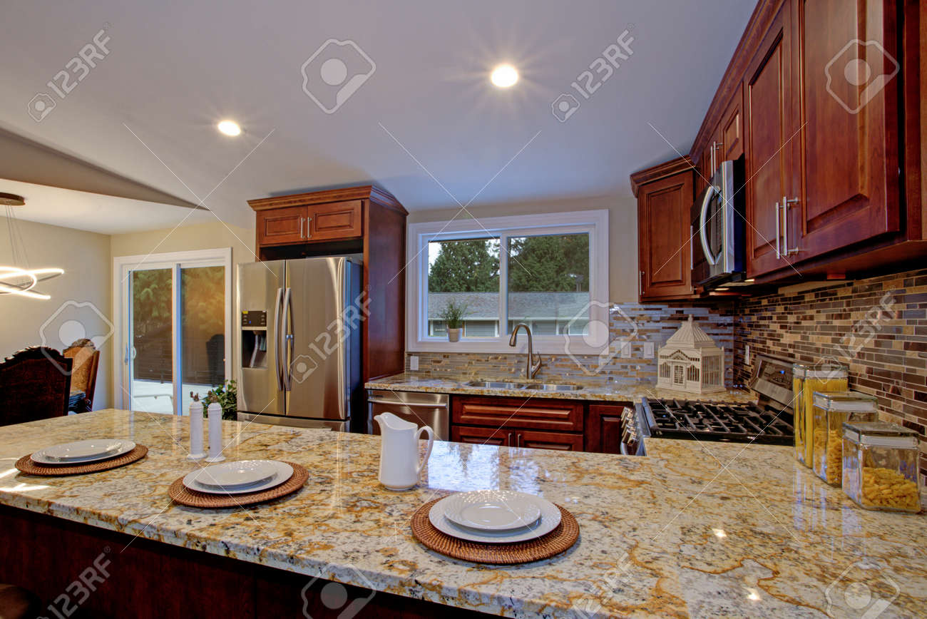 Brown Kitchen Design With Mahogany Kitchen Cabinets Breakfast Stock Photo Picture And Royalty Free Image Image 95634470