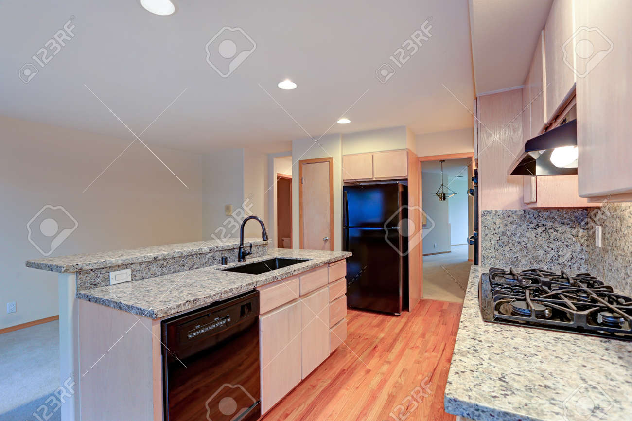 Large Open Kitchen With Granite Counter Tops Maple Cabinets