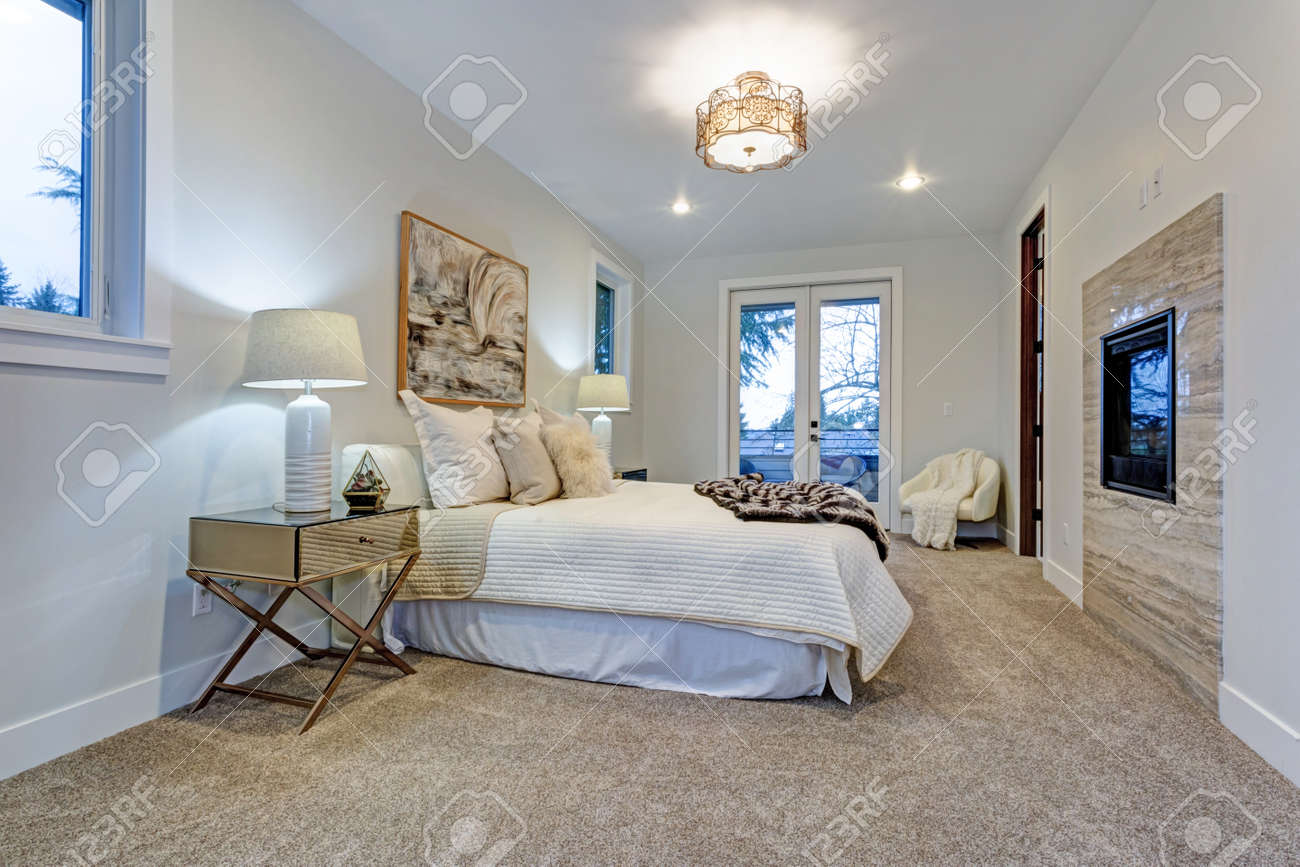 New Luxury Custom Built Home With White Master Bedroom Accented With Exit  To A Large Patio