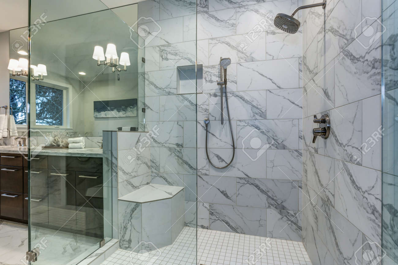 Incredible Master Bathroom With Carrara Marble Tile Surround Stock Photo Picture And Royalty Free Image Image 96675000