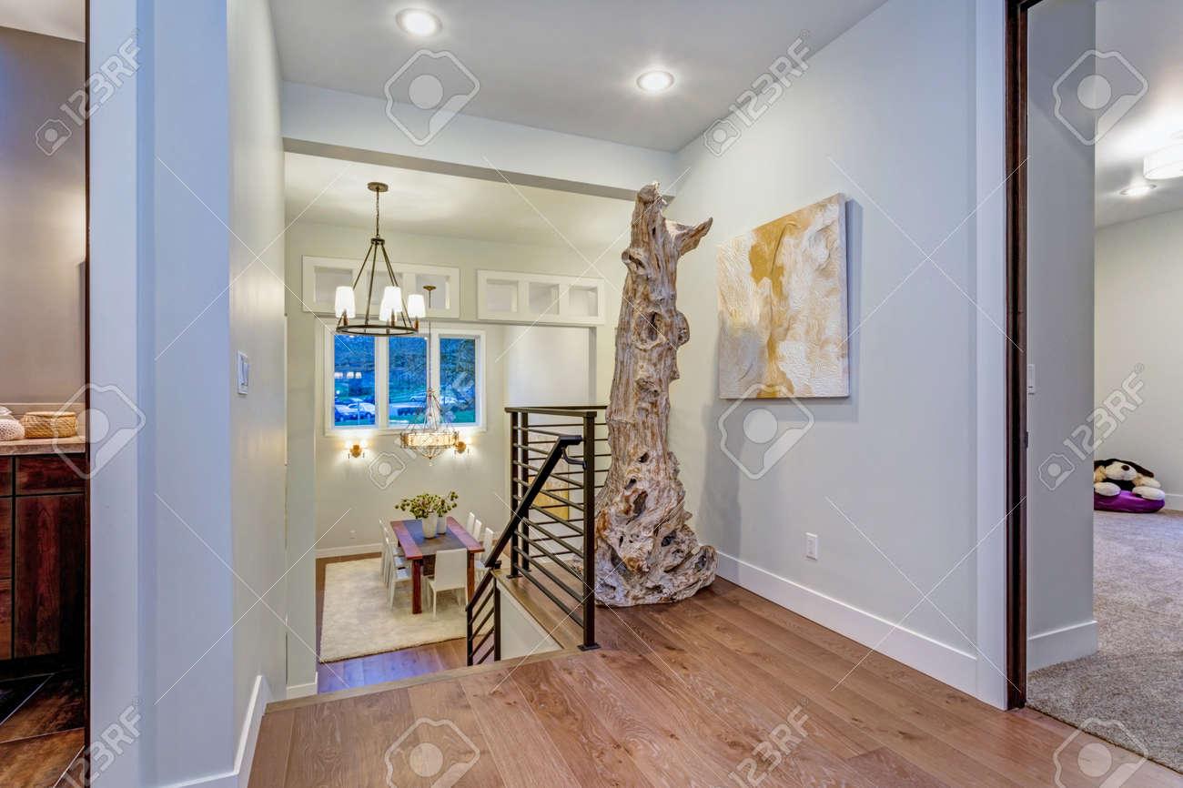 Second Floor Landing With White Walls Maple Hardwood Floor And