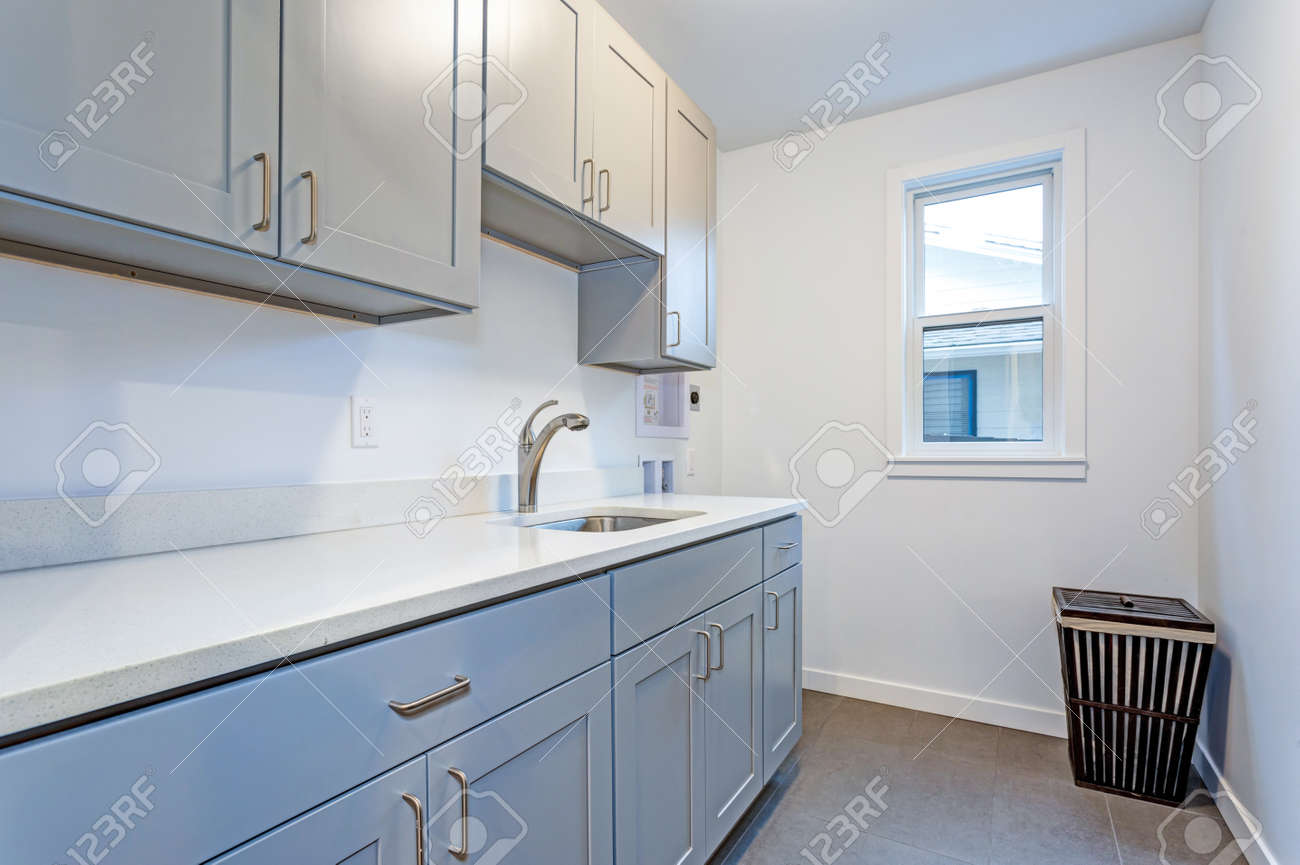 Stock Photo White laundry room with