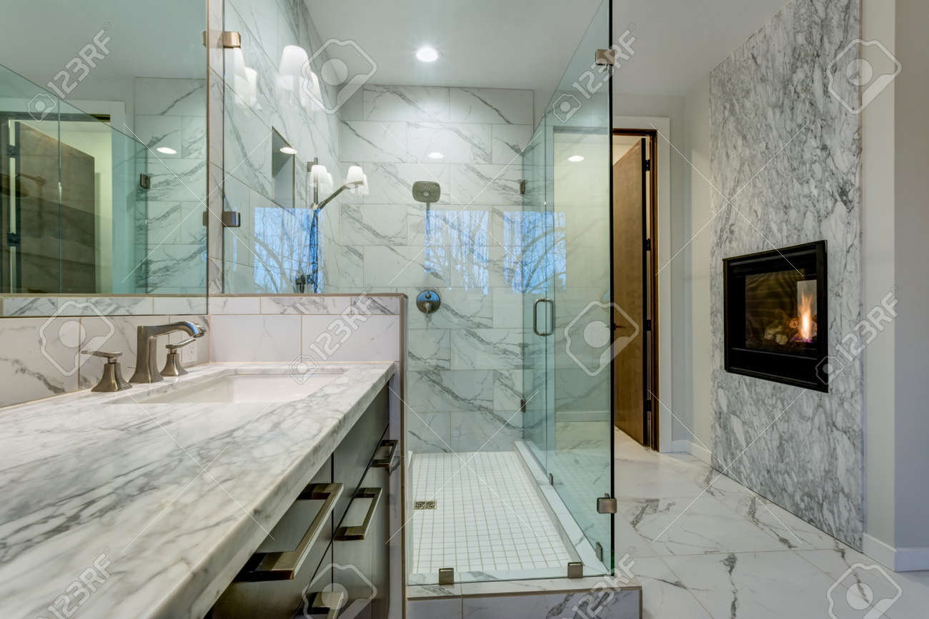 Incredible Master Bathroom With Fireplace Carrara Marble Tile Stock Photo Picture And Royalty Free Image Image 96755416