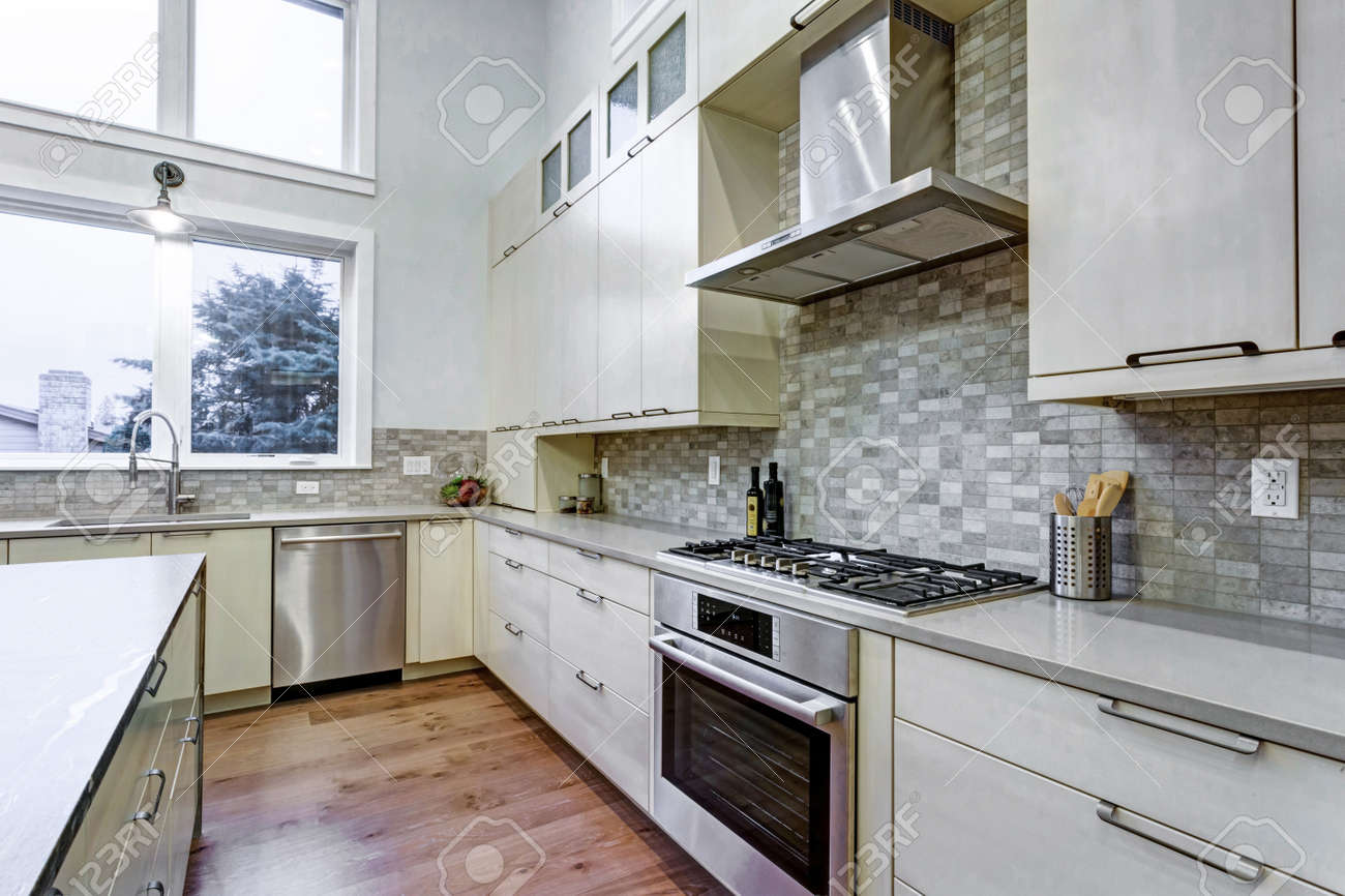 Contemporary White Kitchen With Upscale Kitchen Appliances, Custom Built  Cabinets, Kitchen Island With Granite