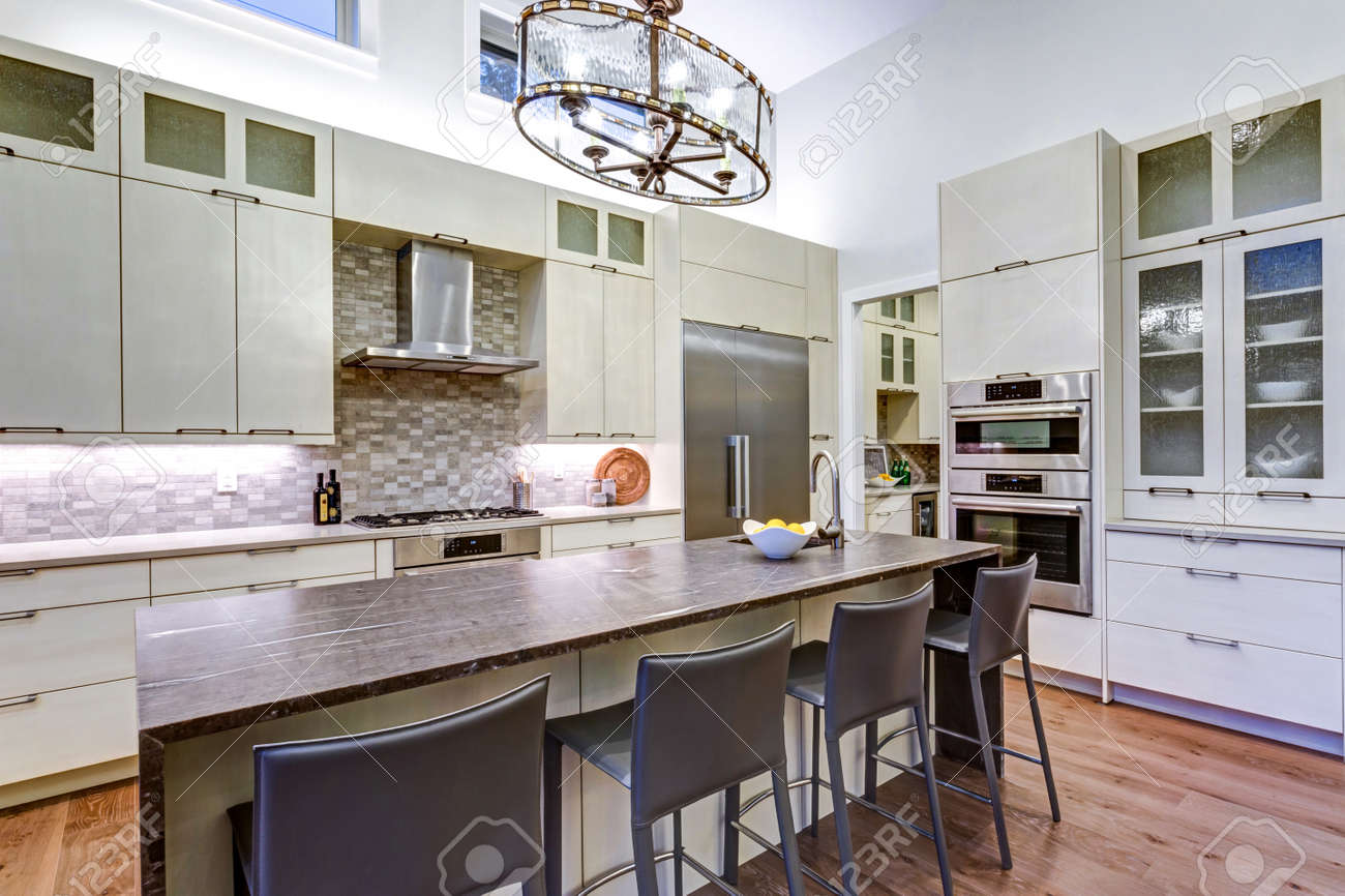 Delicieux Contemporary White Kitchen With Upscale Kitchen Appliances, Custom Built  Cabinets, Kitchen Island With Granite