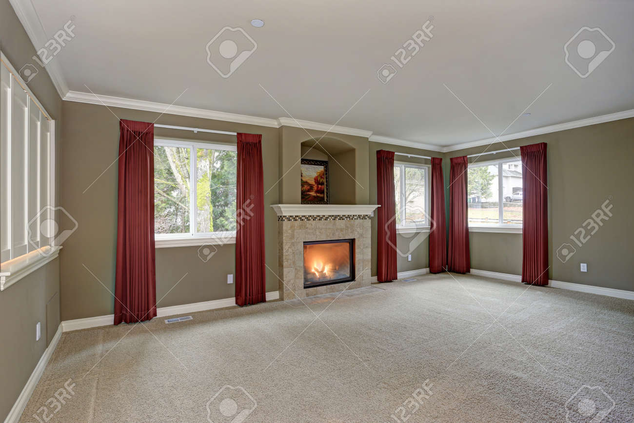 Spacious Red And Gray Living Room Accented With Floor To Ceiling