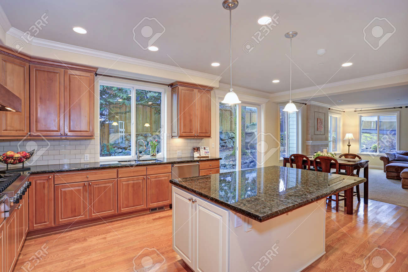 Luxury Kitchen With Kitchen Island Light Wood Cabinets Fitted Stock Photo Picture And Royalty Free Image Image 96708539