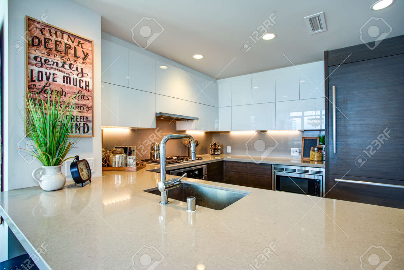Modern spacious chef\'s kitchen design with white and black accents..