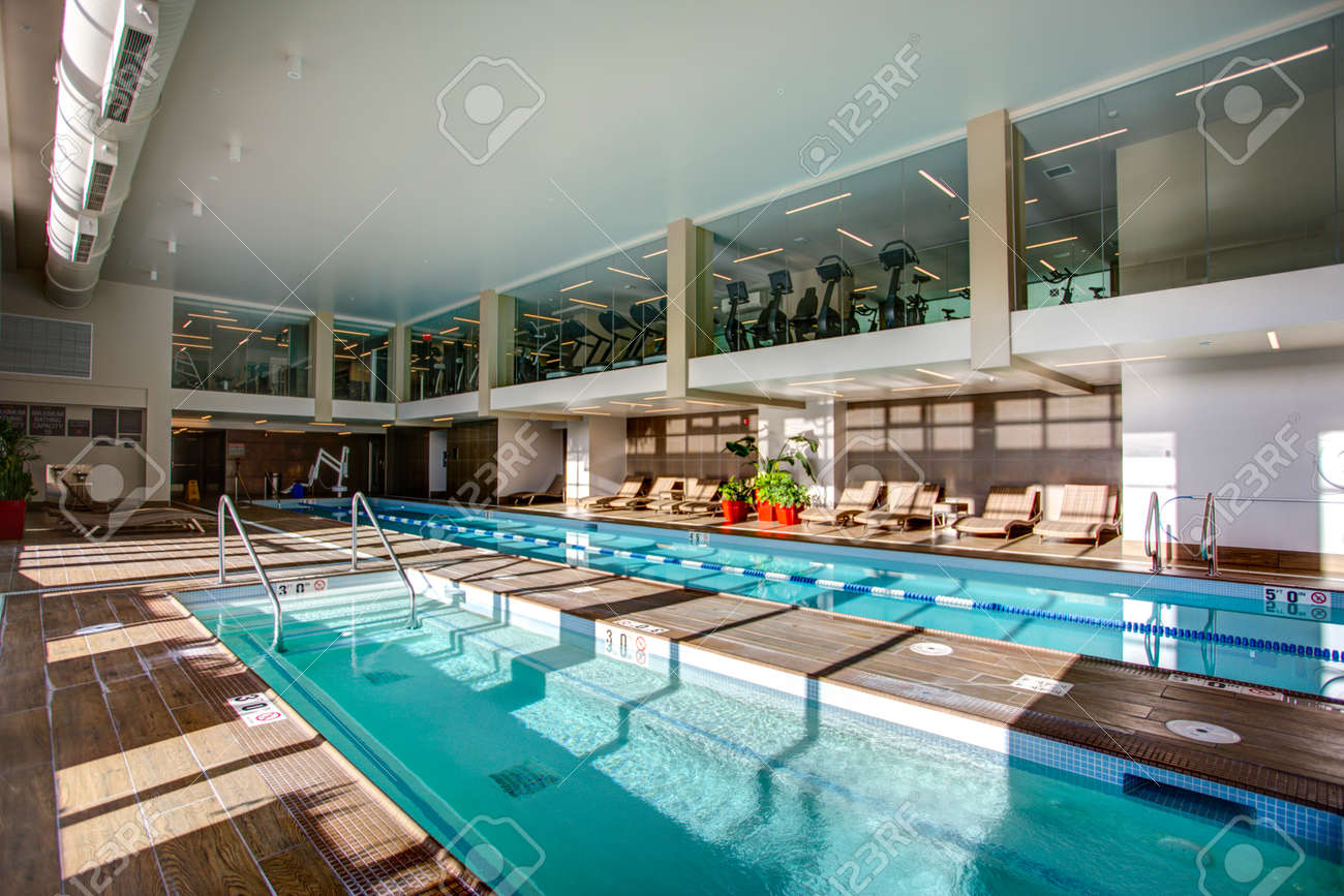 Upscale Indoor swimming pool with swim lanes and 2 level gym..