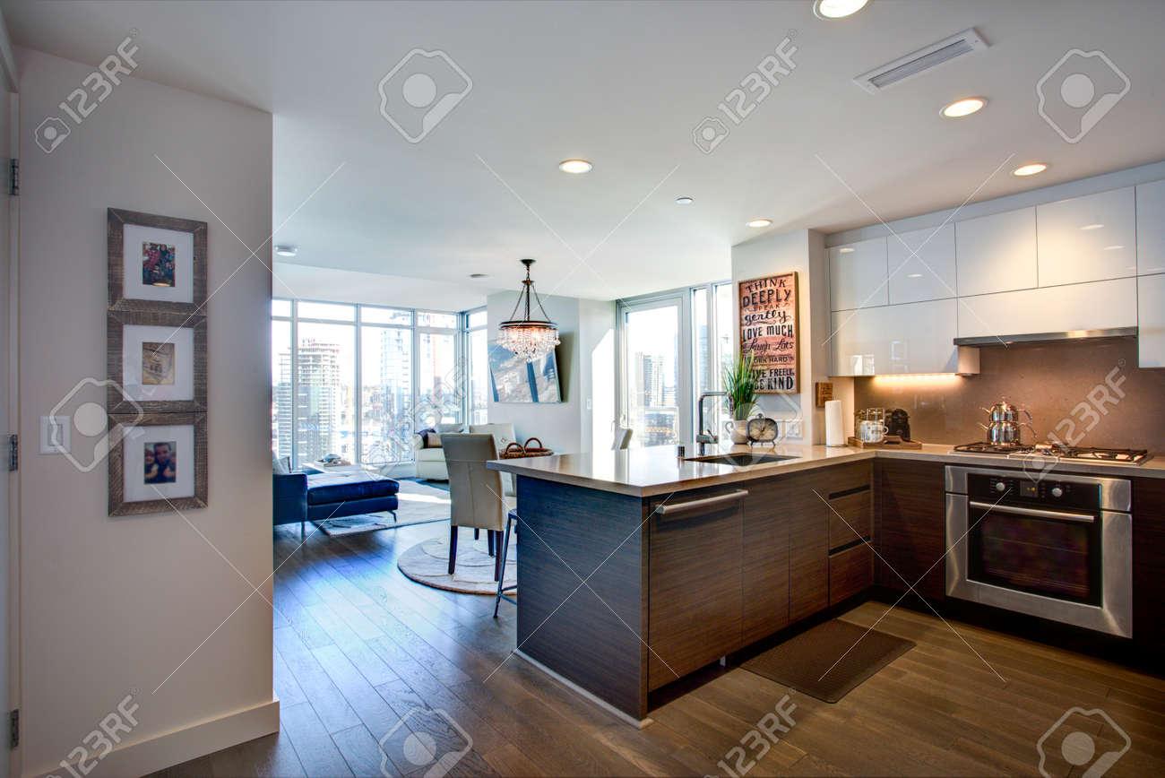 Modern spacious chef\'s kitchen design with white kitchen cabinets..