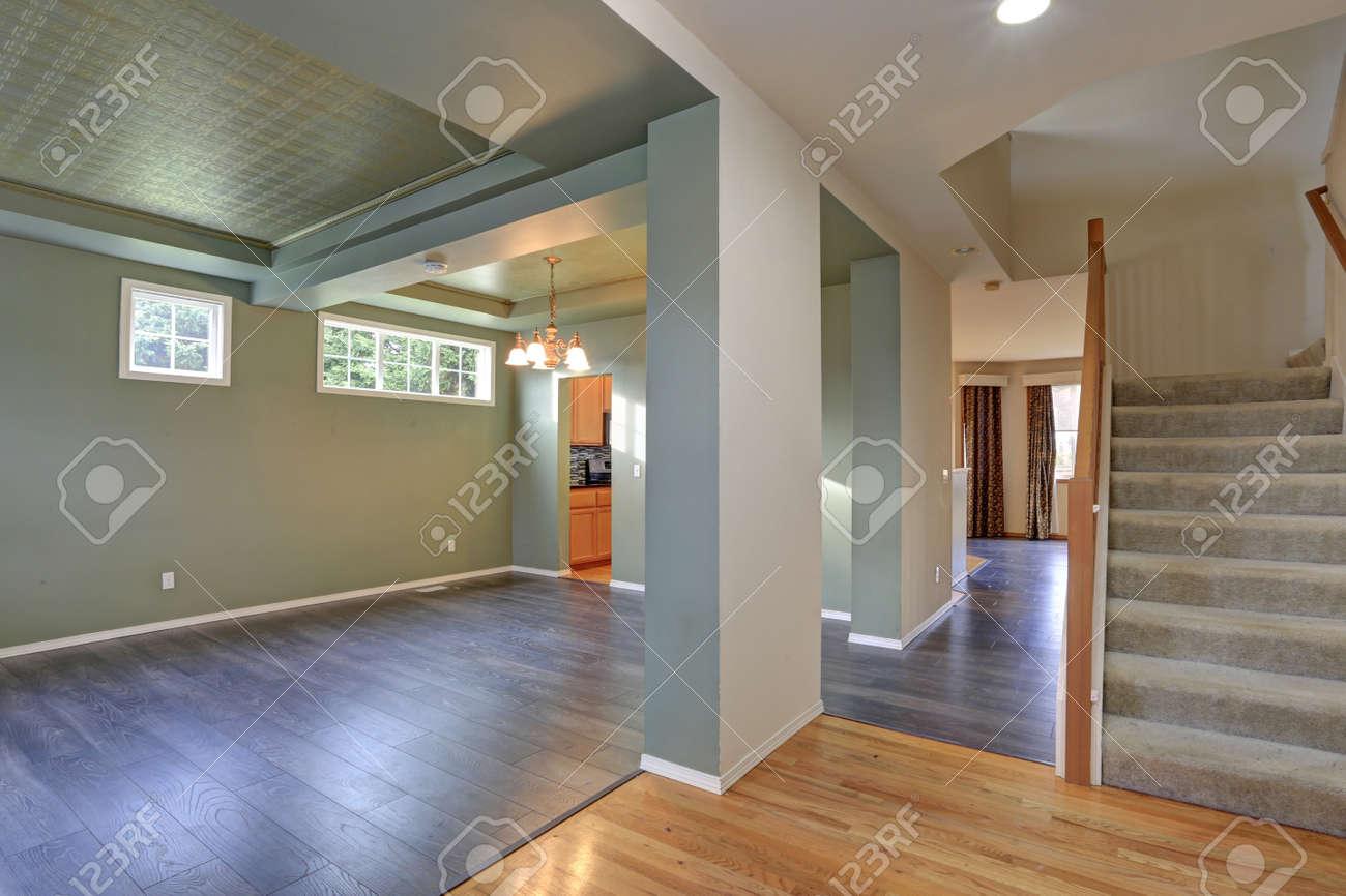 Spacious Empty Living Room Interior With Dark Grey Hardwood Floor
