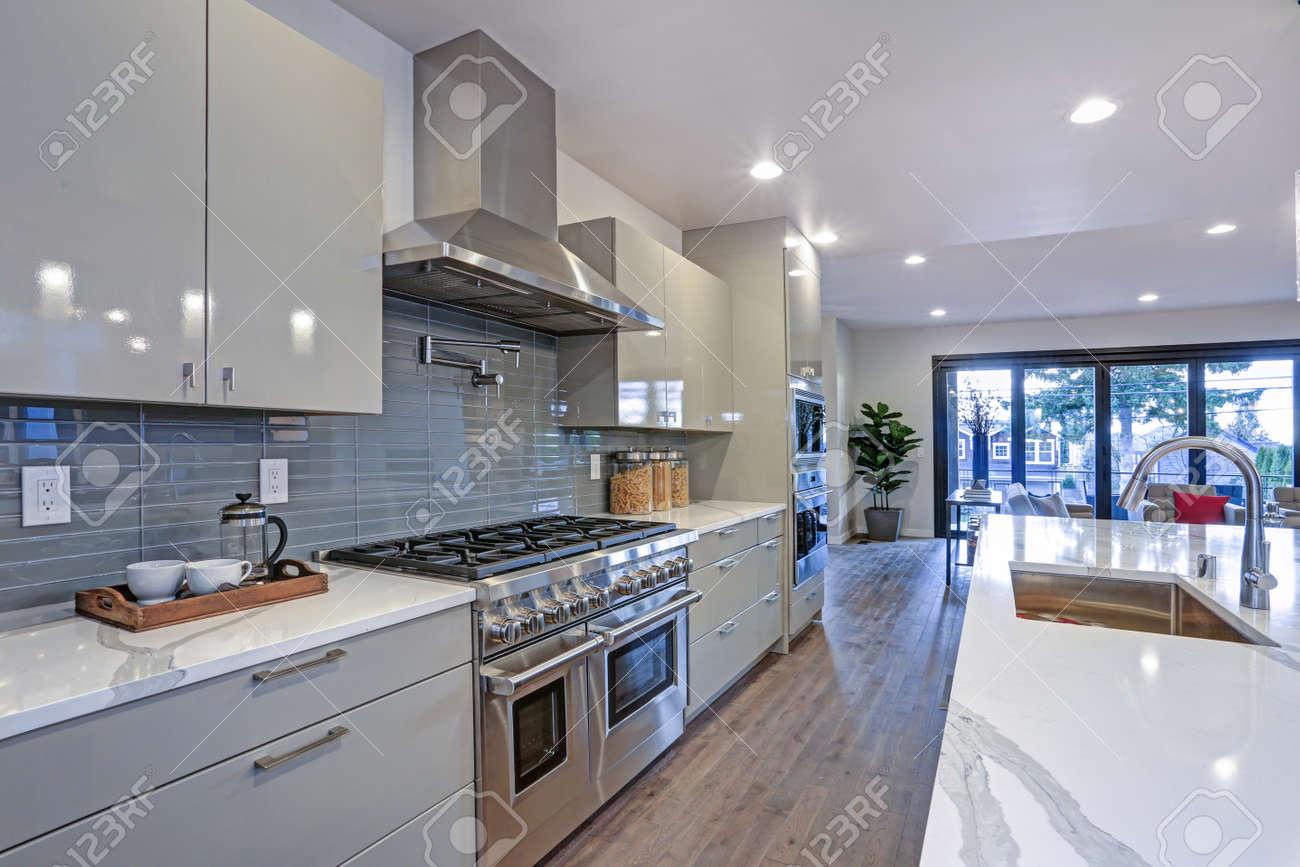 - Sleek Modern Kitchen Design With A Kitchen Peninsula, Glossy