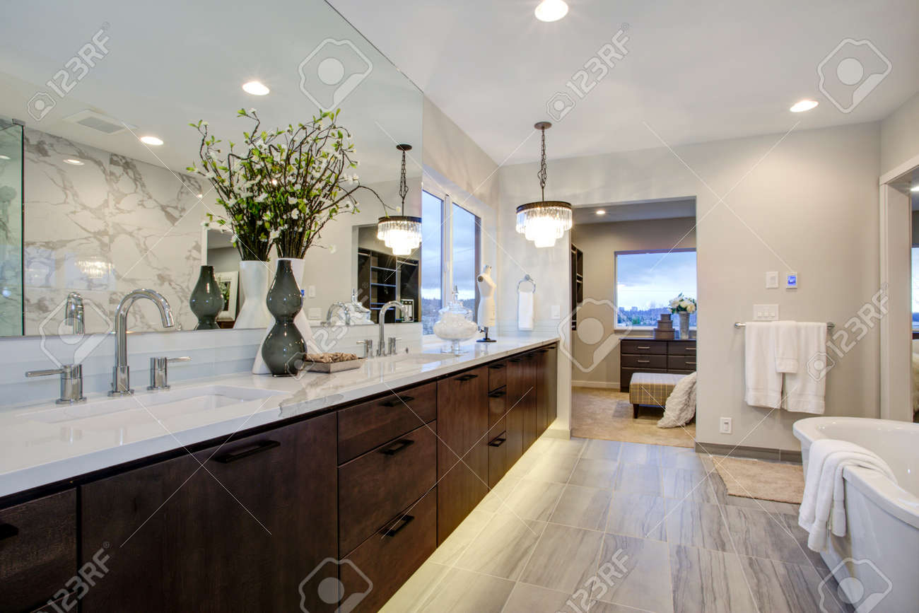 White And Gray Calcutta Marble Bathroom Design With Radiant Floors Stock Photo Picture And Royalty Free Image Image 97873906