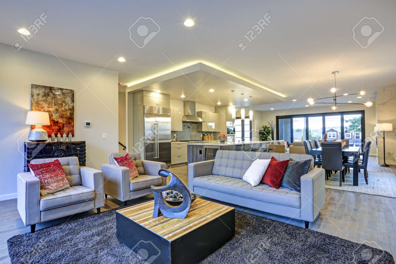 Large Luxury Home Interior With Open Floor Plan Features Modern White  Kitchen, Spacious Dining Area