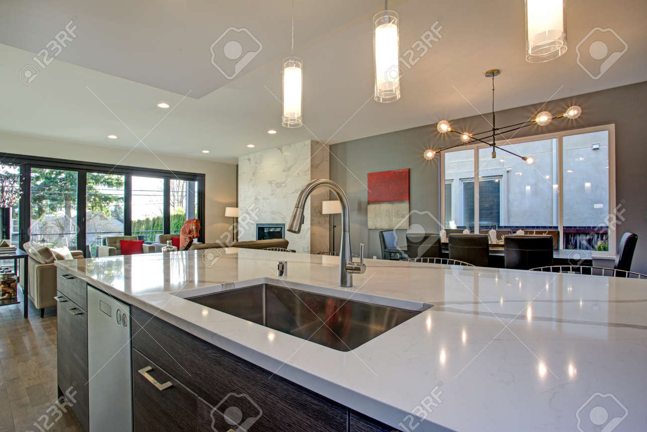 Large Luxury Home Interior With Open Floor Plan Features Modern White  Kitchen Island, Spacious Dining