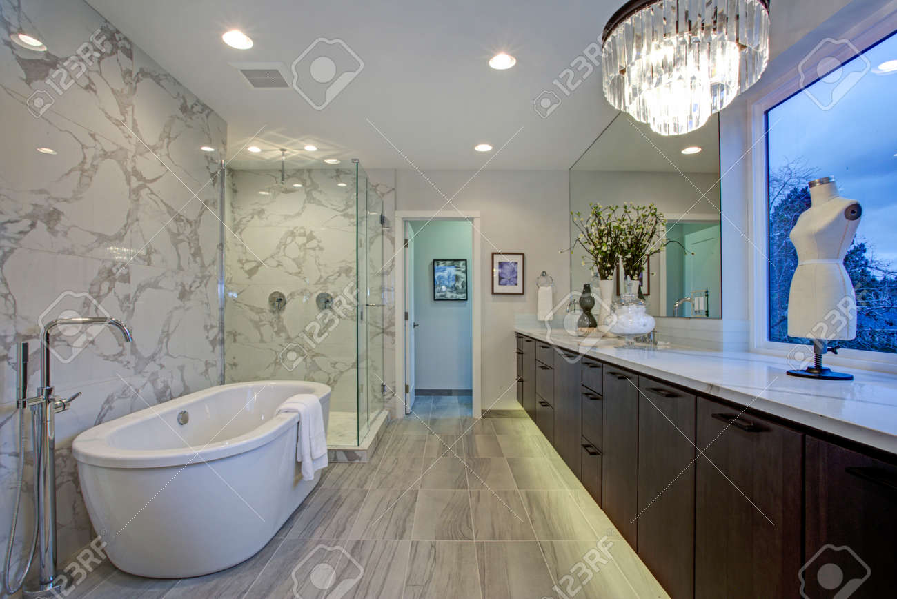 White And Gray Calcutta Marble Bathroom Design With Radiant Floors Stock Photo Picture And Royalty Free Image Image 97874822