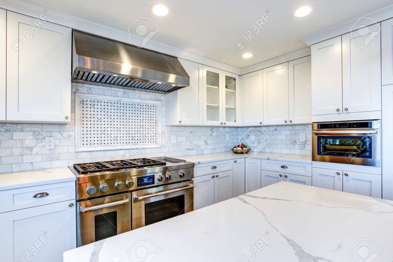 White Kitchen With Stainless Steel Hood Over Gas Cooktop And Stock Photo Picture And Royalty Free Image Image 100260265