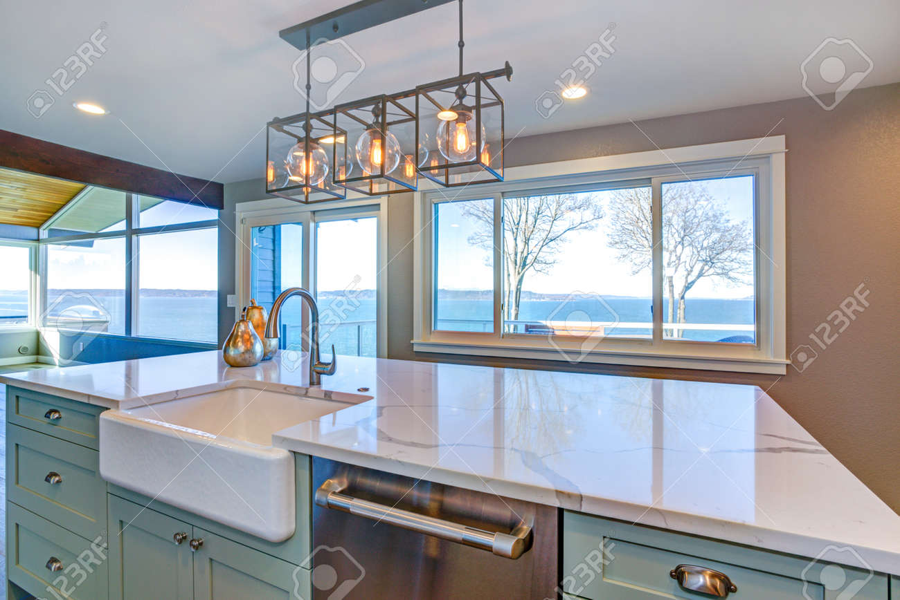 Beautiful Kitchen Room With Green Island, Farmhouse Sink And.. Stock ...