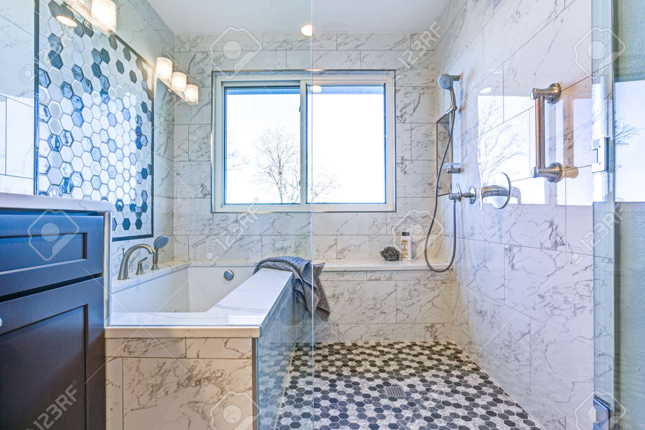Luxury Bathroom With Marble Tile Surround And Mosaic Accent Wall ...