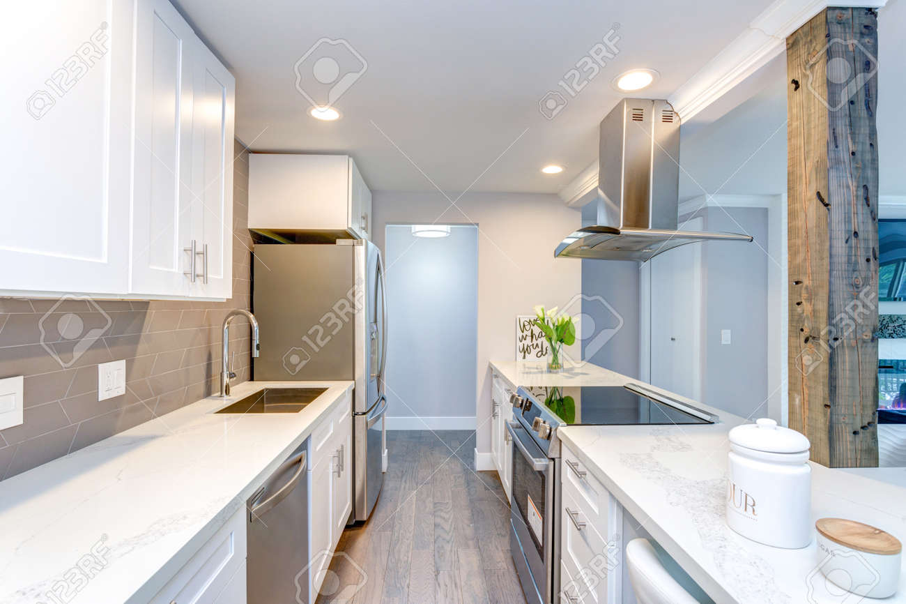 White Small Kitchen With Stainless Steel Appliances In Modern Stock Photo Picture And Royalty Free Image Image 104976996