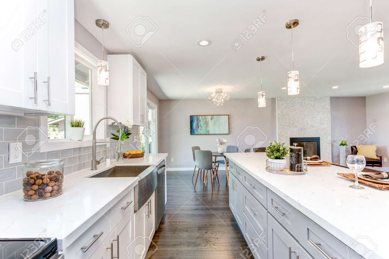 Gorgeous kitchen with open concept floorplan, white cabinets and huge island. - 107742918