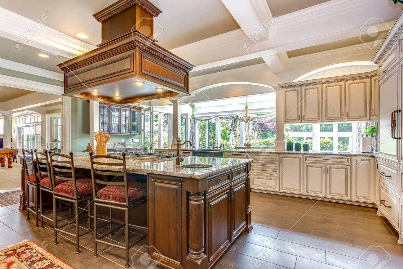 Stunning kitchen room design with large bar style island and coffered ceiling. - 108106289