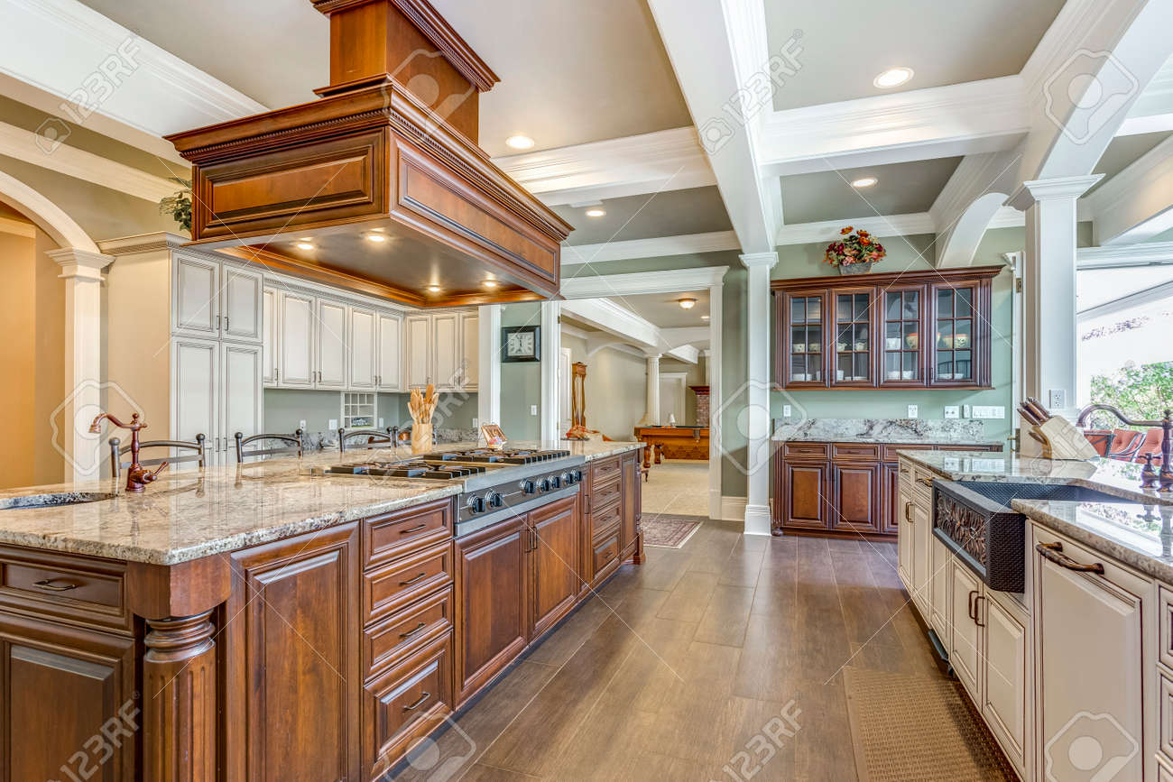 Stunning kitchen room design with large bar style island and coffered ceiling. - 108106290